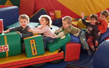 children make a train from big soft play shapes